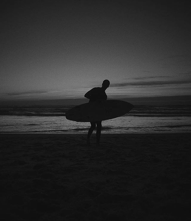 Night Photography by @oscarmatt . . .  #surf #surfing #surfer #surfboard  #sea #wave #waves  #reflection #illusion  #blacksun  #silhouette #photography  #photo #surfphotography  #surftrip  #nature #wild  #dark #light #black #white #mirror #alone #surrealism #beach #night #bw #blackandwhite #blackandwhitephotography