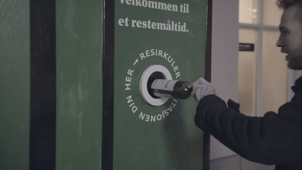 - To enter the event space, guests recycled their wine bottle invitations in a customized recycling station. When bottles were recycled, a sensor opened the door to the next step of the experience.