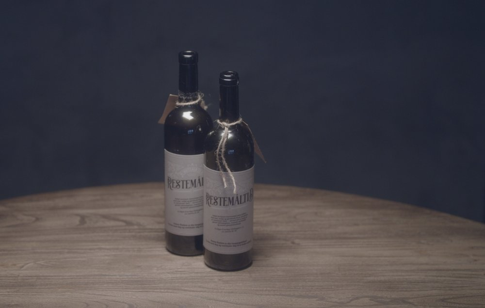 Invited guests were sent recycled wine bottles as invitations. -