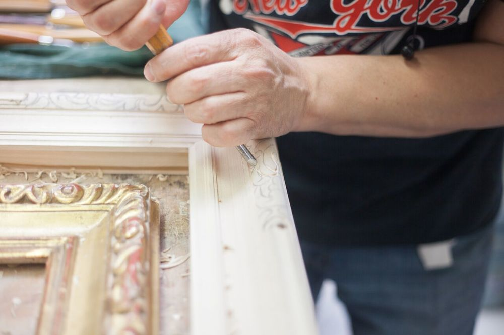 A hand-carved frame requires at least 5 different artisans to work on the frame work on the frame from start to finish over the course of 6 weeks.