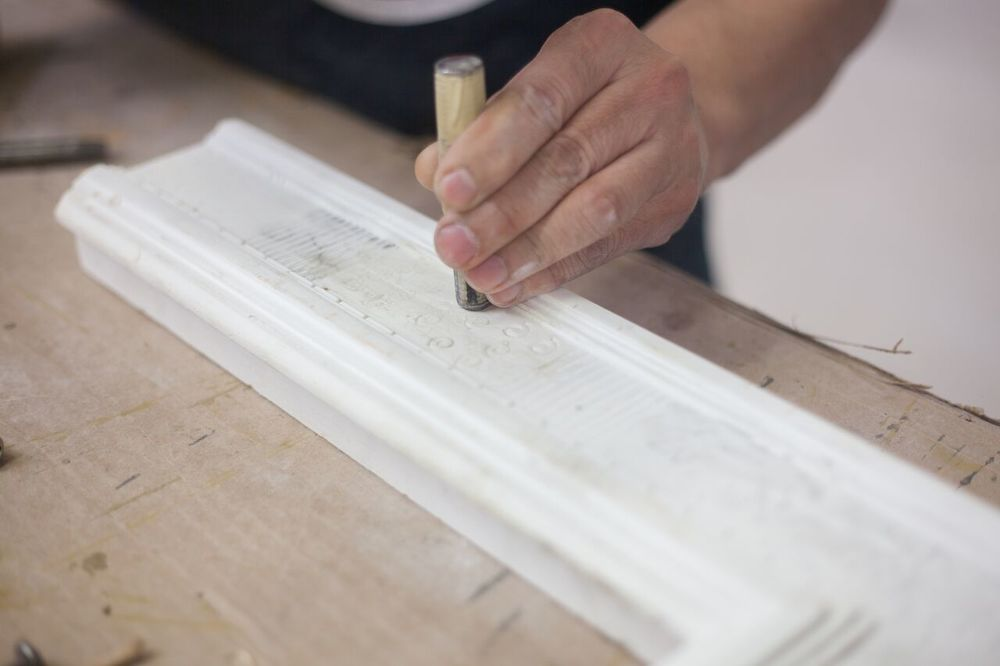 Granitto, also known as punch work, is part of the bulinatura (incised gesso) but in this case instead of drawing with a sharp point, it's stamped on the gesso with a designed nailhead using a mallet.