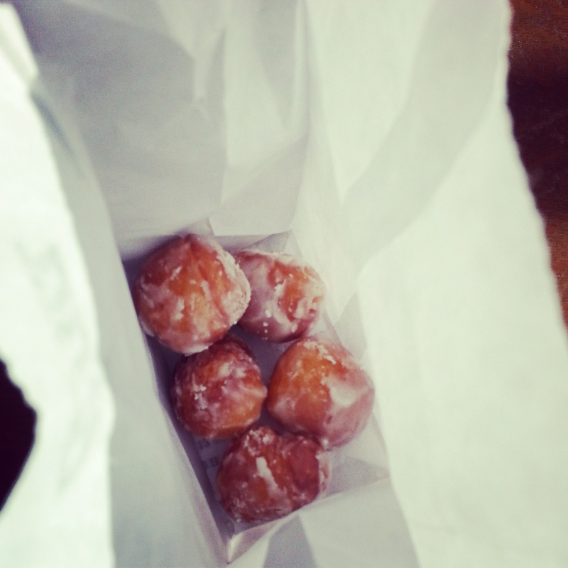 five union square donut holes (one eaten)  (sonya kovacic)