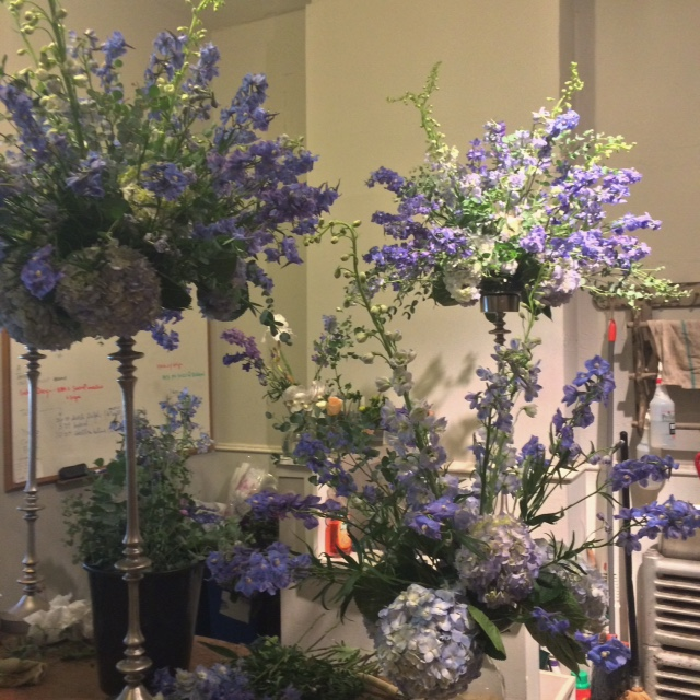 Tall centerpieces for the big blue wedding.  There are eight of these, and then eight urns and five smaller footed bowls.  Luckily, the bridal party consists of just five bridesmaids and five groomsmen.