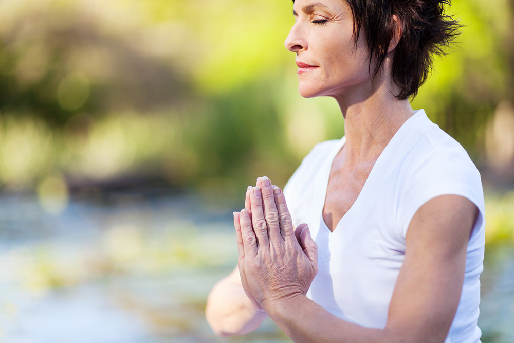 middle age woman doing yoga meditation