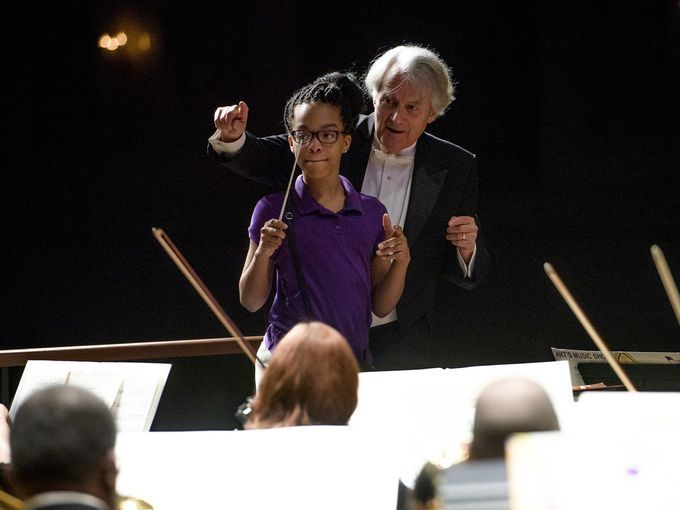Montgomery Symphony Orchestra conductor Thomas Hines gets some volunteer help conducting during the MSO's Children's Concert at the Davis Theatre in Montgomery, Ala., on Thursday March 30, 2017. (Photo: Mickey Welsh / Advertiser)