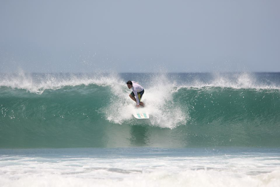 Surfing a two meter wave in Tamarindo, Costa Rica