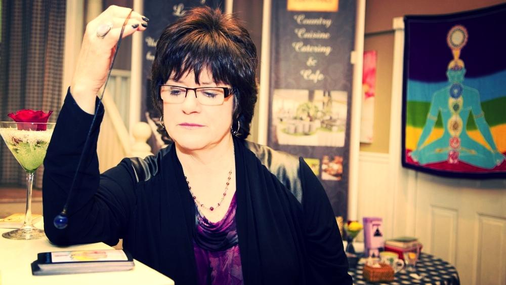 Janice using a pendulum