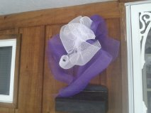 Be sure to get your purple bow from Flowers By Sue and proudly display your Pledge for Parity!