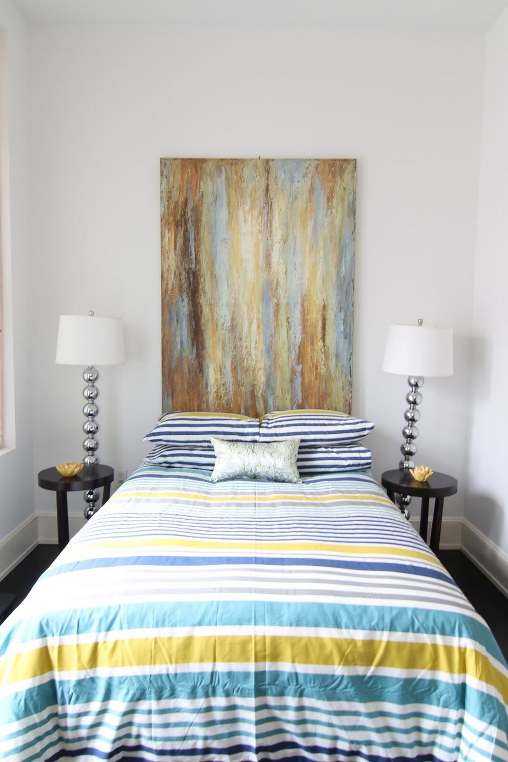 A funky guest bedroom for an area known to be a little different keeping in sync with buyers expectations.