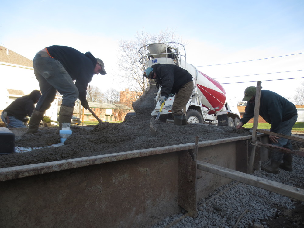 We had a break in the typically cold Syracuse March and took full advantage... Finally pouring the cement.