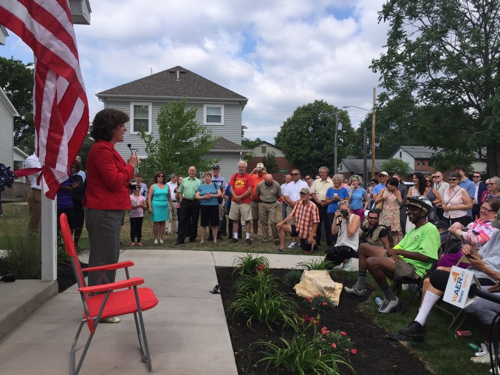 Mayor Miner delivering her speech in front of our Rose Ave unit.