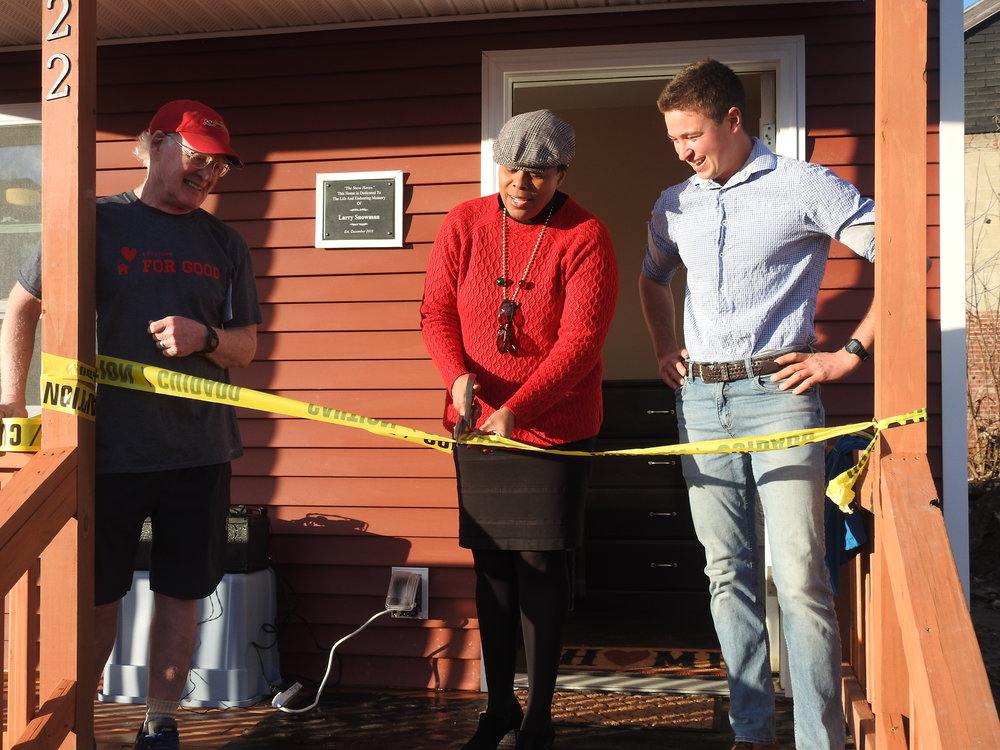 """Deputy Mayor of Syracuse, Sharon Owens, cutting the """"ribbon"""" on our most recent two homes on Bellevue Ave."""