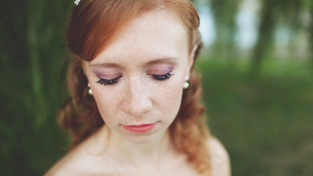 This bride's purple eye shadow made her gorgeous red hair pop!