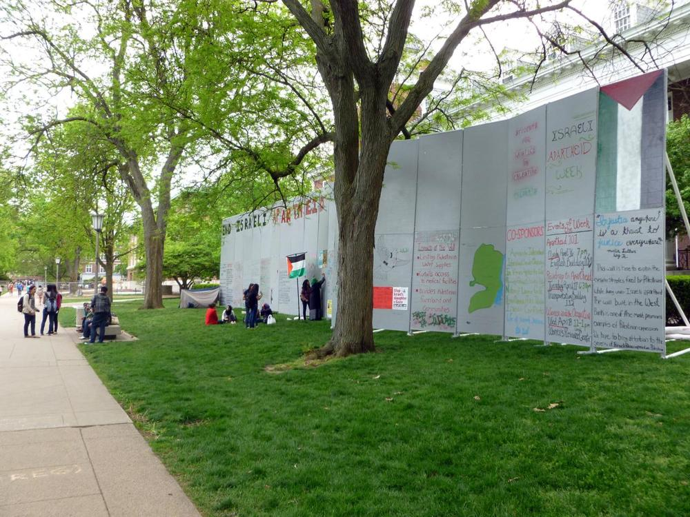 SJP displays a mock wall at the University of Illinois at Urbana-Champaign in April 2012. (Benjamin Stone/Flickr)
