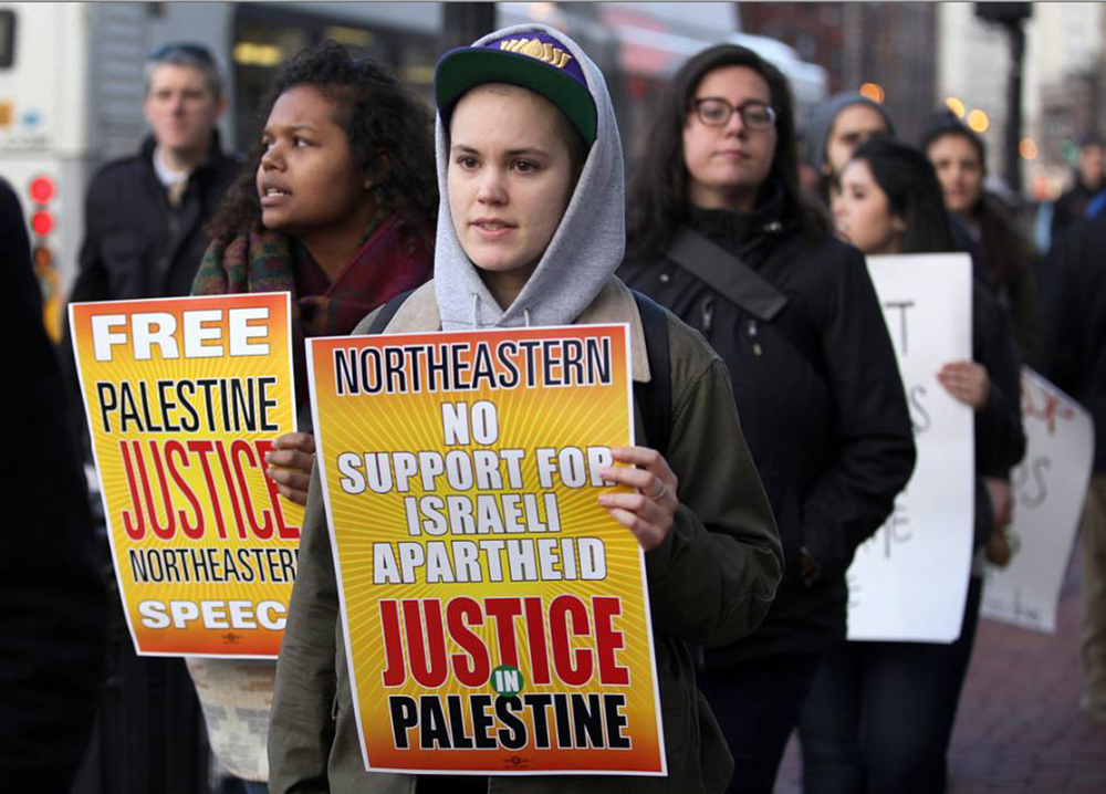 Students and local activists protest the suspension of SJP on April 2, 2014 at Northeastern University. (Maria Amasanti)