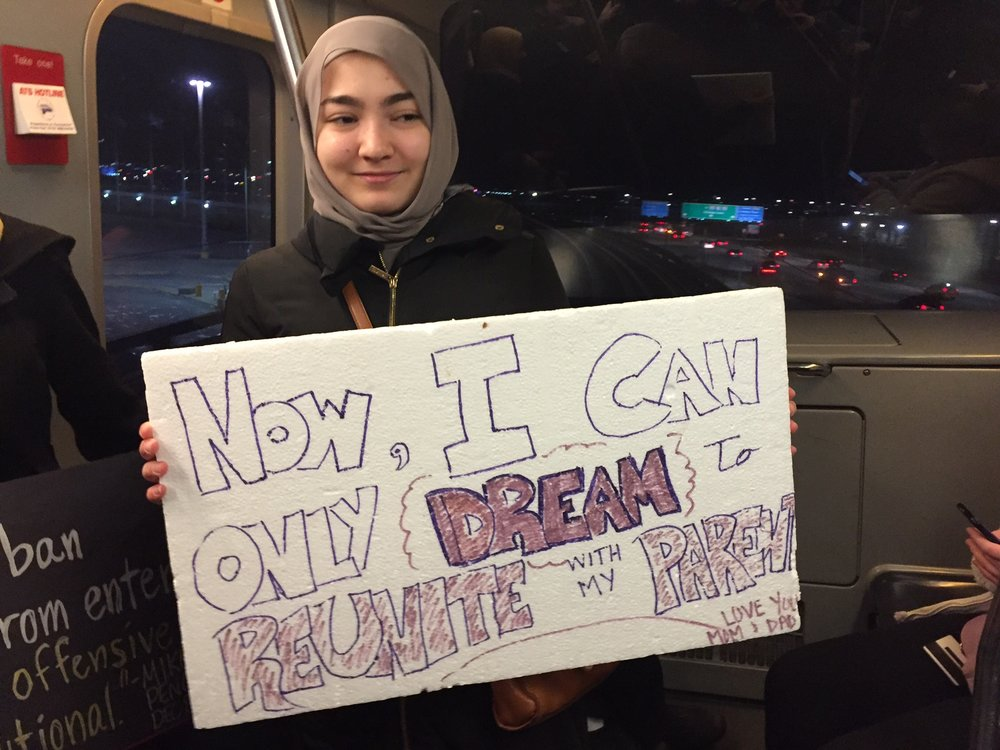 A young Syrian woman protests Trump's Muslim ban at O'Hare International Airport on January 29. Photo: Angela Campion