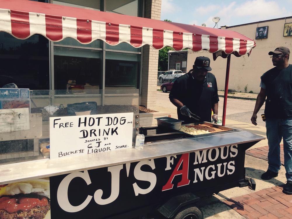 CJ flips free hot dogs.