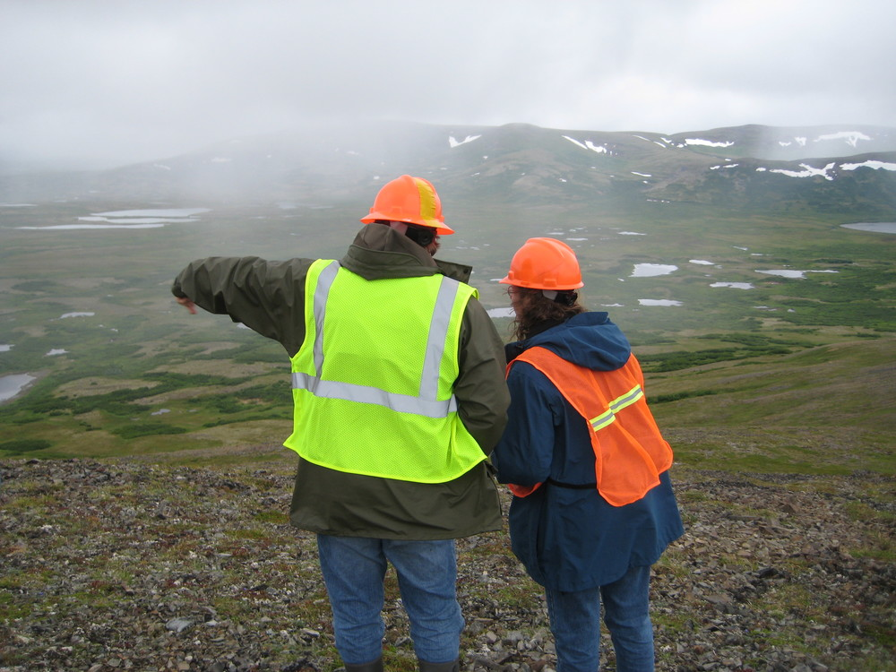 Pebble Limited Partnership employees looking out over the proposed Pebble Mine site. (Photo by Tim Sohn, 2011)