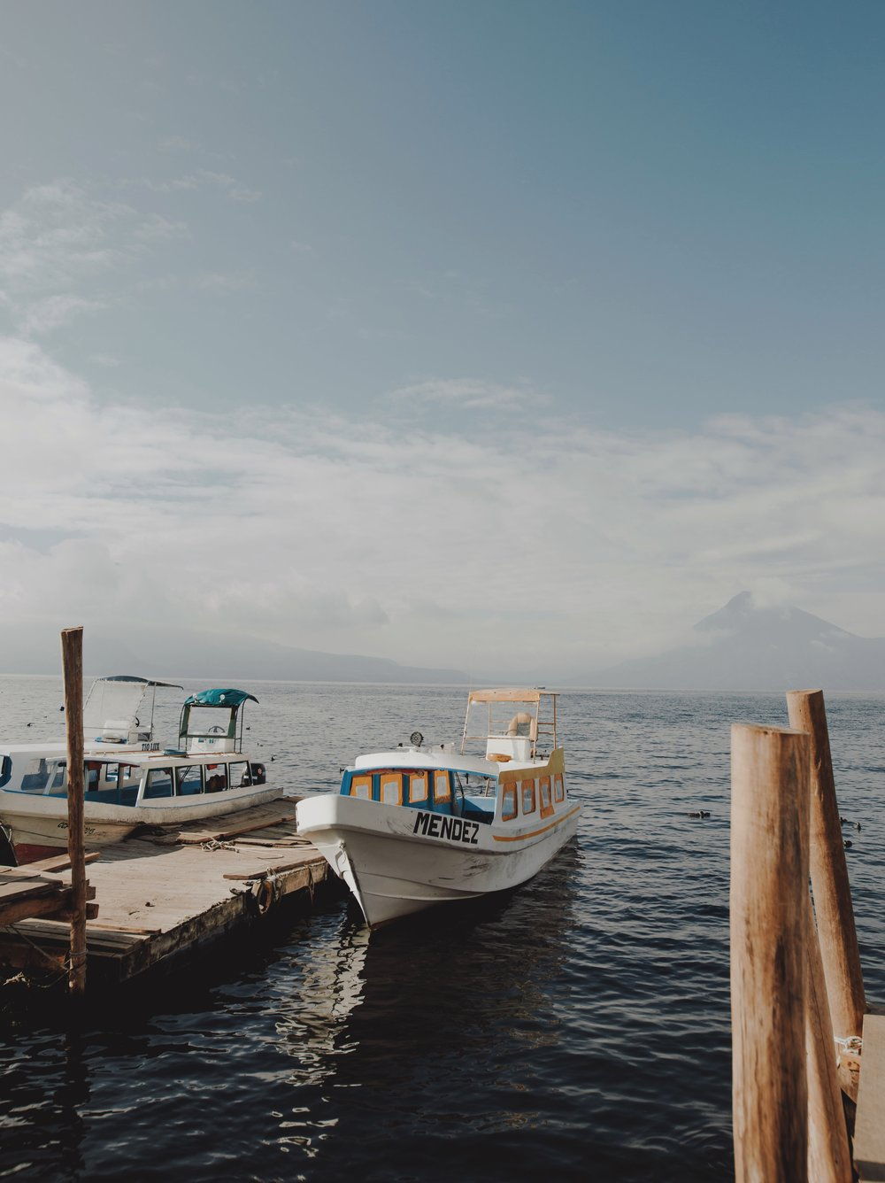 on our second day at Lake Atitlán , we took a boat in Panajachel, where we ate breakfast at a local cafe, went to the artisan market, and took in the beautiful sunshine, colors, and textures of the beautiful town.