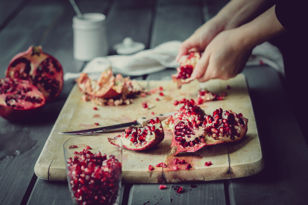 deseeding pomegranates.jpg