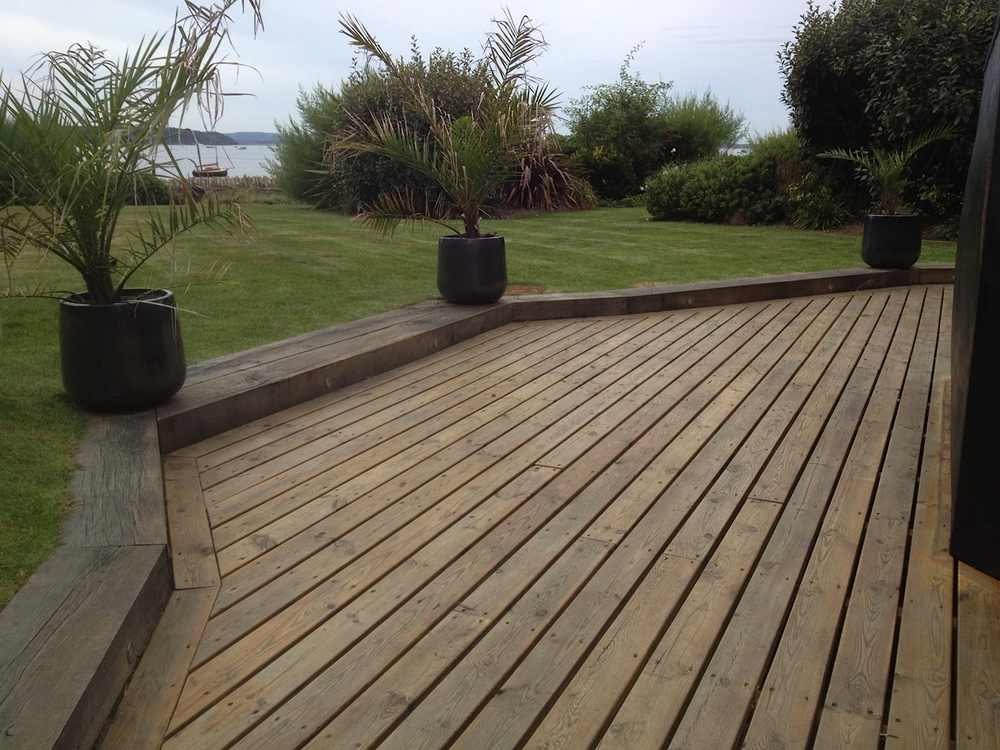 Smooth Decking sunken with oak sleepers to retain lawn