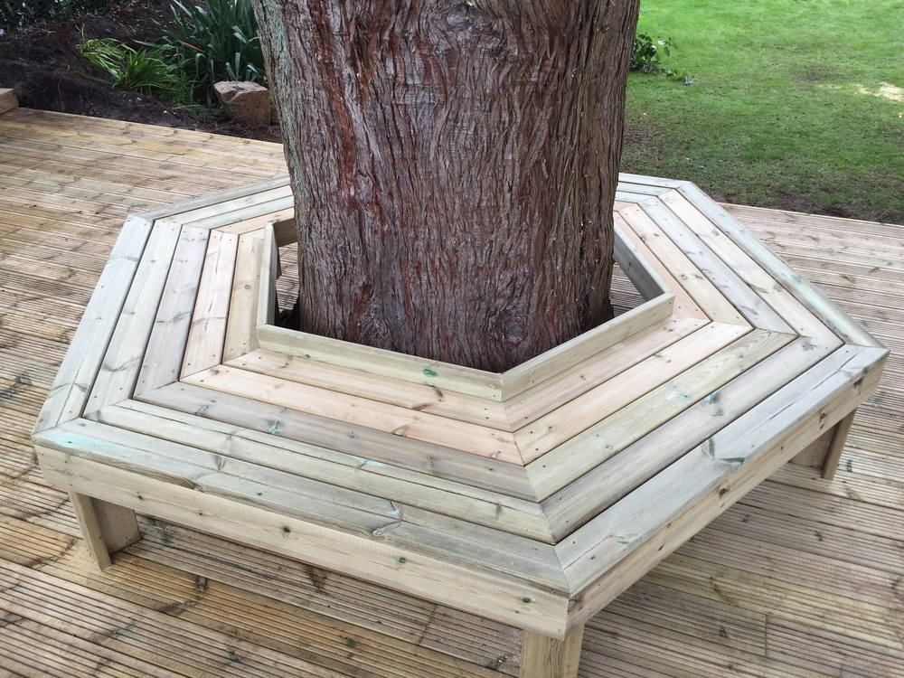To Make A Feature Of The Tree We Have Built A Hexagonal Tree Seat.