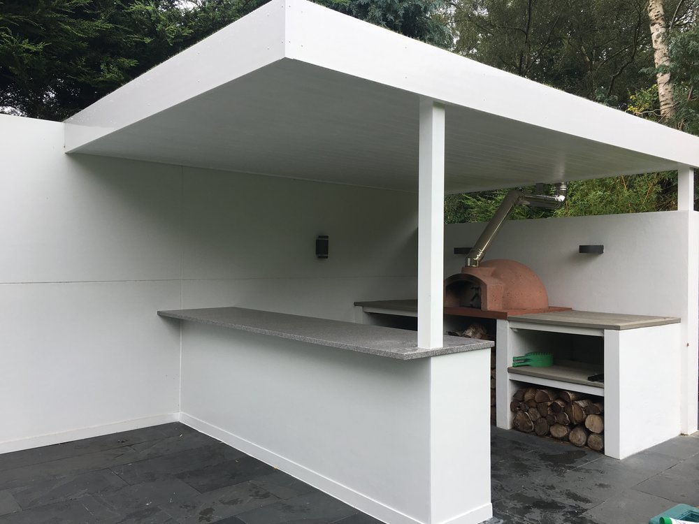 A bit of a different project for us. We were asked to build a pergola style roof, breakfast bar and shelving to create an area for cooking and eating pizza.