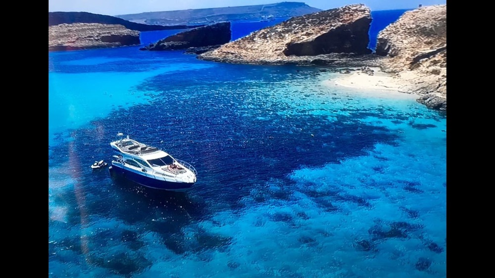 Picture: AZIMUT Malta Charter Club - AZIMUT 46 Flybridge at anchor in Blue Lagoon, Comino, Malta.