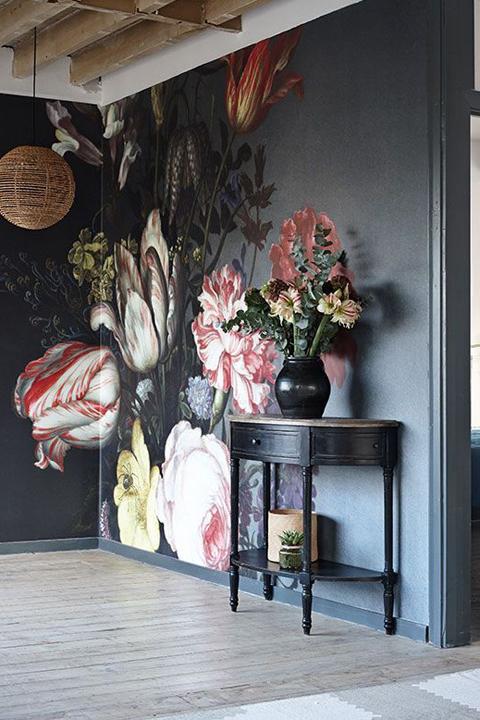 Floral drama on a dark wall.