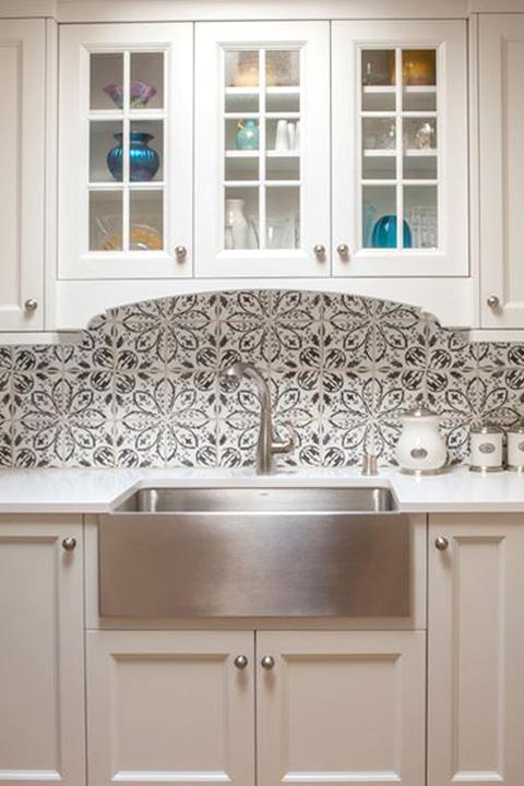 A delicate floral backsplash by Statements In Tile/Lighting/Kitchens/Flooring.