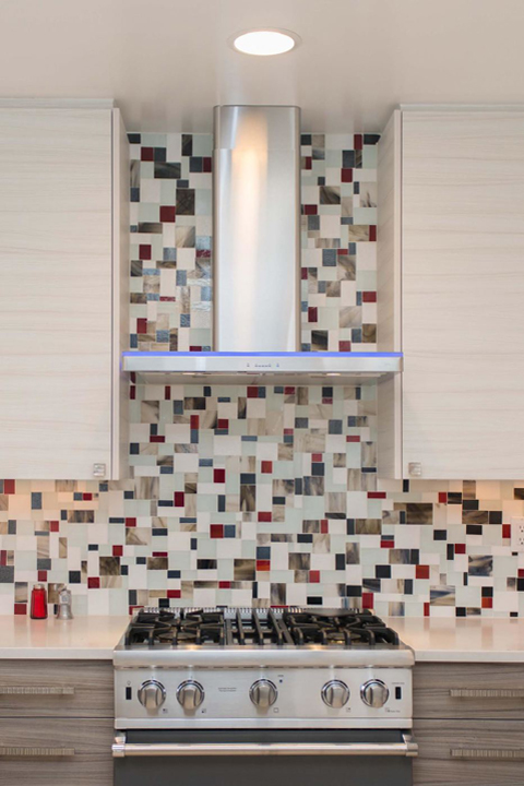 A back splach by Statements In Tile with graphic shapes and colors.