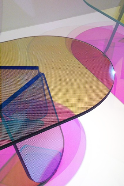 Patricia Urquiola's delightfully iridescent Shimmer coffee tables for Glas Italia change color as you move around the piece. Salone Del Mobile 2016.