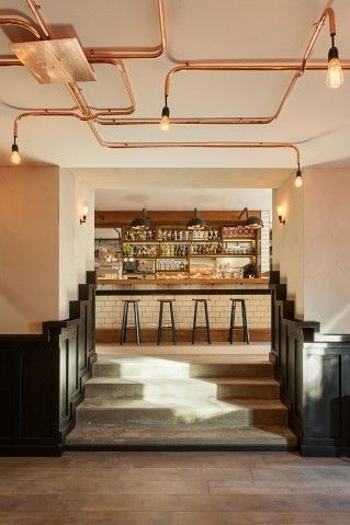 Interior of De Ebeling Restaurant in Amsterdam with exposed copper piping..