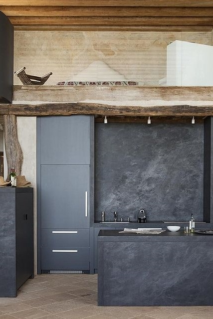 Rough-hewn dark stone kitchen - Statements in Santa Fe