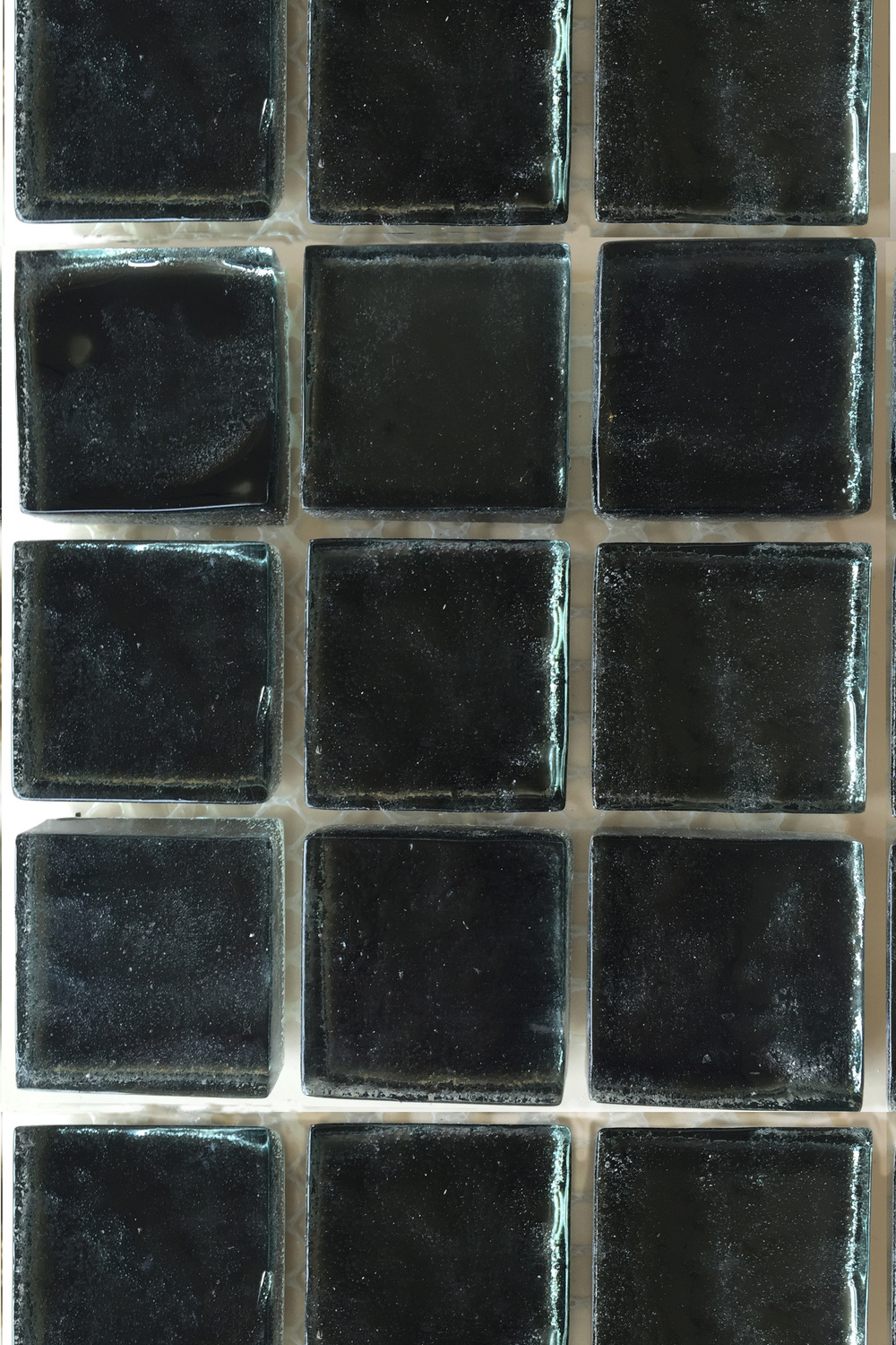 Dark bluegreen glass mosaic tile.