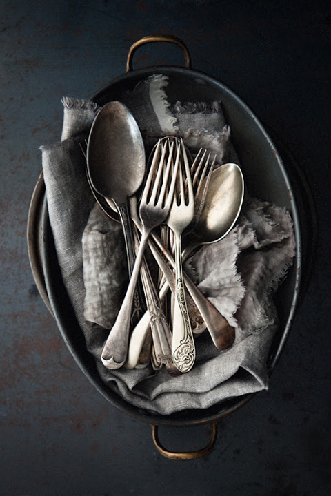 Vintage Silverware in a black bowl.
