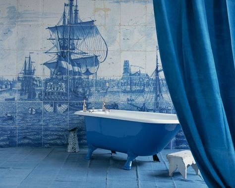 Antique tile decorates a bathroom wall and adds a maritime feel. Via Pinterest, source unknown.