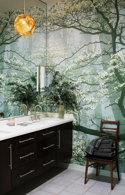 Create a different mood with an over scaled mural in a small bathroom.