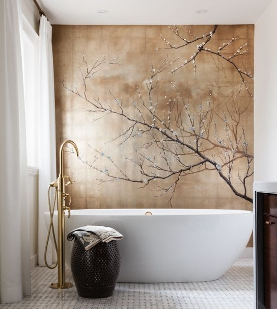 A dramatic Asian inspired mural of cherry blossoms adorns the wall behind the tub in this modern master bathroom. By Casey Design | Planning Group. Photography by Ted Yarwood.