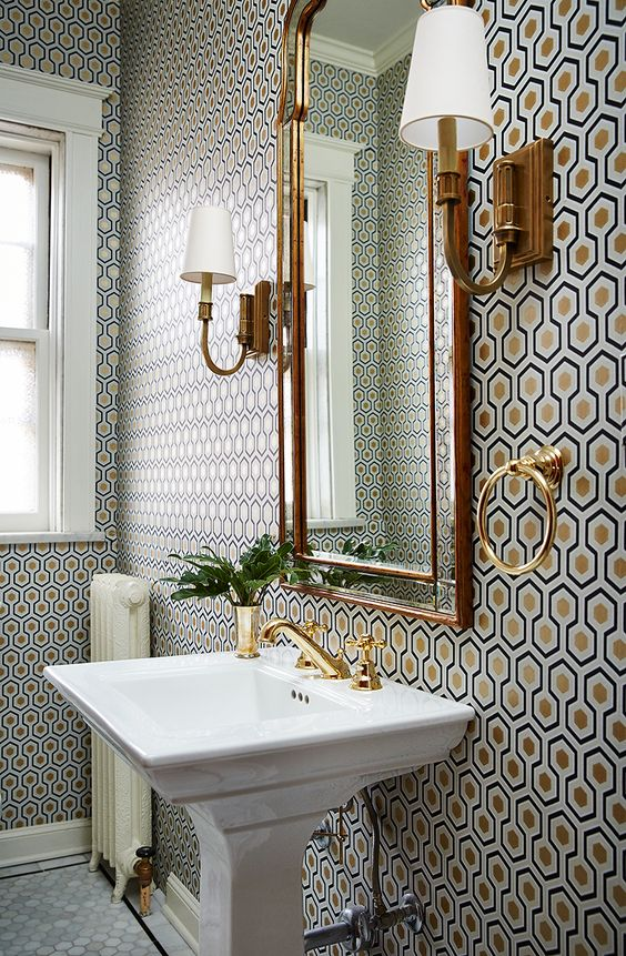 Bathroom with golden accents by Amie Corley Interiors.