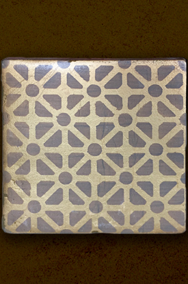 Gold patterned porcelain tile.