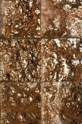 Golden textured mosaic tile.
