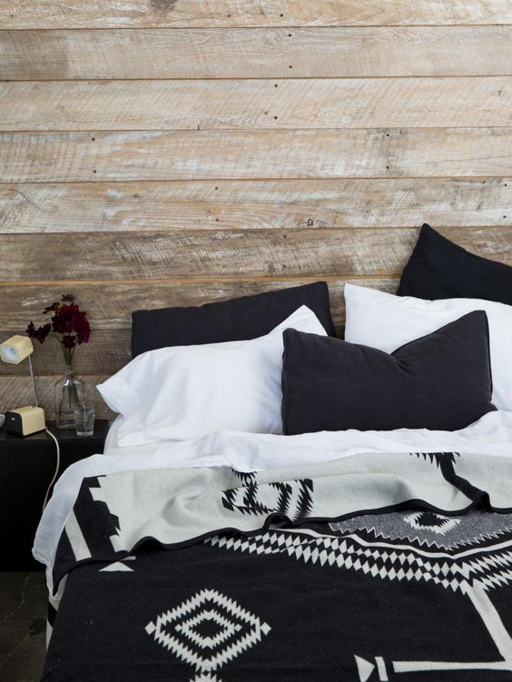 Black & white Pendleton blanket in rustic bedroom setting. Est Magazine.