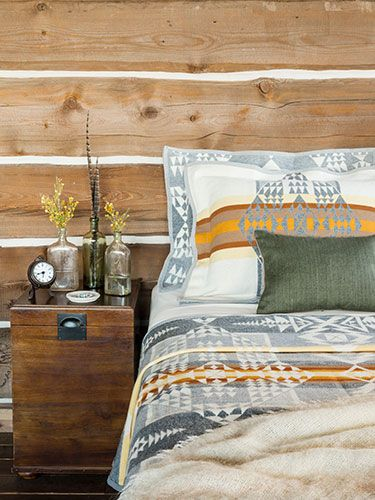 Pendleton style bedding in a log cabin.