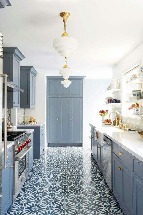 Blue kitchen with patterned cement tile.