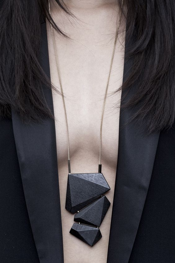 Black angular long pendant.
