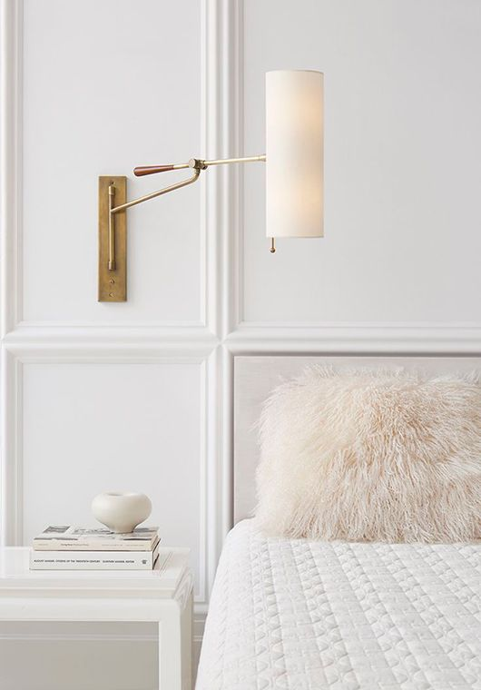 Brass swing arm bedside reading lamp.