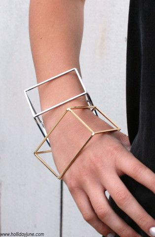 Rectangular prism cuff bracelet in gold and silver tones by Holiday June.