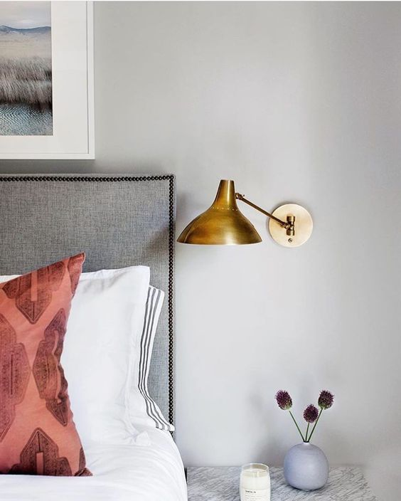 Modern bedroom with bronze vintage style bedside light wall sconce.