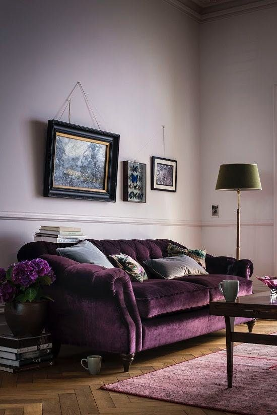 Lavender walls living room withe deep purple velvet couch, Apartment Therapy.